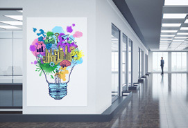 Open space office with colourful lightbulb artwork